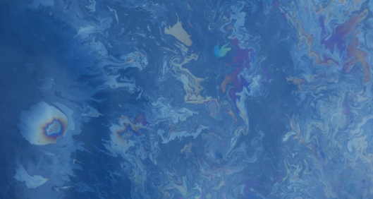 Oil glistens on the Gulf of Mexico in late spring 2010, over a month after the Deepwater Horizon spill began. The photo was taken from a research vessel that scientists used to studied methane consumption by microbes in the ocean. The photo shows an area roughly 3 meters on a side.